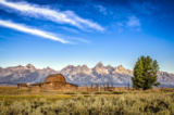 Martin Molcan - Scenic view of Grand Teton mountain range and abandoned barn